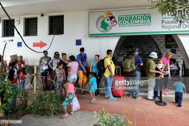 People line up at the Colombian migrantions office near the Simon Bolivar International Bridge in Cucuta Colombia on the border with Venezuela on...