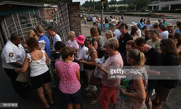 People line up at the front gate of Graceland Mansion to visit the home of Elvis Presley August 16 2007 in Memphis Tennessee This week marks the 30th...