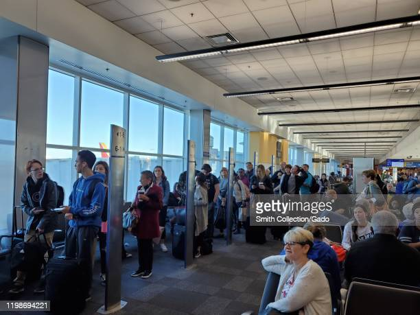 People line up based on boarding group numbers to board a Southwest Airlines flight at Oakland International Airport in Oakland California January 5...