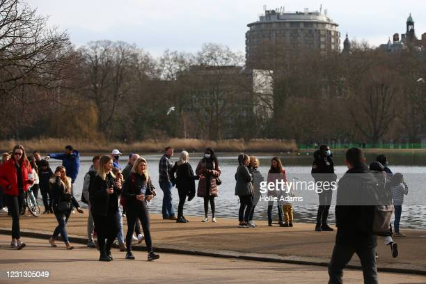 People line up beside a kiosk at Hyde Park on February 21, 2021 in London, England. The British government is expected to announce tomorrow its plans...