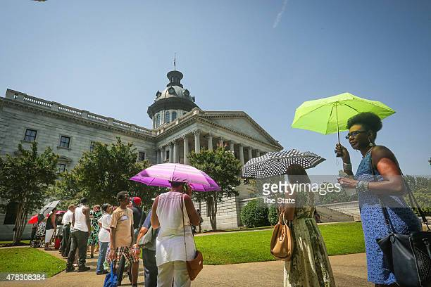 People line up early to pay their respects at the viewing of Sen Clementa Pinckney on June 24 2015 as he laid in state at the South Carolina State...
