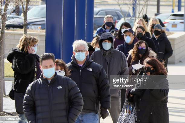 People line up for COVID-19 vaccinations at Nassau Community College on January 10, 2021 in Garden City, New York. Nassau County now has two vaccine...