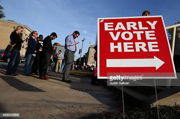 People line up for early voting outside of the Pulaski County Regional Building on November 3 2014 in Little Rock Arkansas With one day to go before...