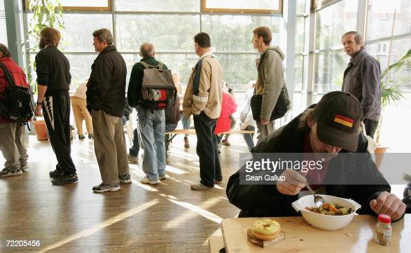 People line up for soup at a soup kitchen at a Fransiscan ...