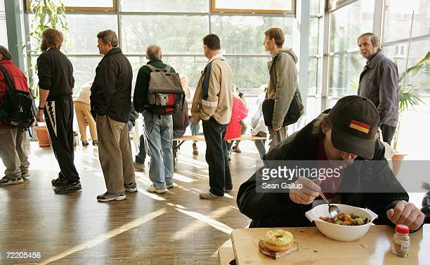 People line up for soup at a soup kitchen at a Fransiscan Monastery October 18 2006 in Berlin Germany Politicians have launched debates over the...