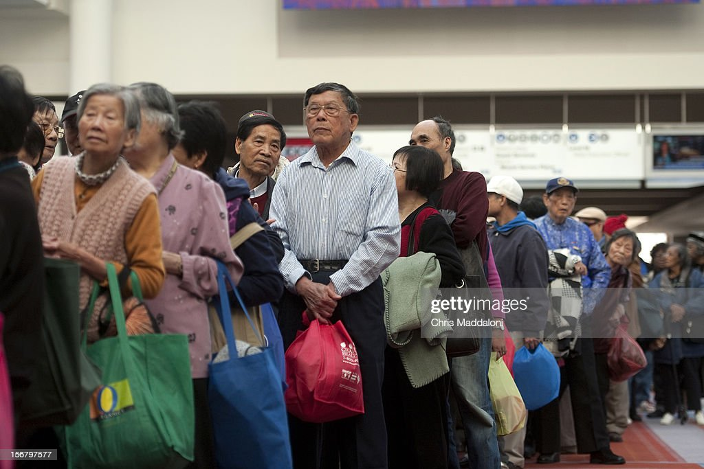 People line up for the 13th annual Safeway Feast of Sharing at the Washington Convention Center. More than 5000 people were expected for the free Thanksgiving meal, job and health fair.