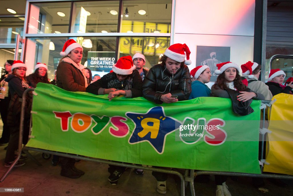 People line up for the Black Thursday sale at the Toys 'R' Us store in Times Square November 22, 2012 in New York City.The store got a head start on the traditional Black Friday sales by opening their doors at 8pm on Thanksgiving night.