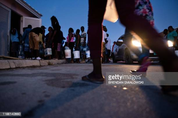 People line up for water at the government complex after Hurricane Dorian on September 5 in Marsh Harbor Great Abaco Bahamas The death toll from...