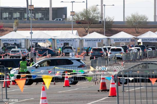 People line up in cars to receive the COVID-19 vaccination at State Farm Stadium on February 11, 2021 in Glendale, Arizona. Maricopa County is in...