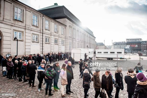 People line up in front of Christiansborg Palace Church where the late Price Henrik is lying in Castrum Doloris in Copenhagen on February 17, 2018....