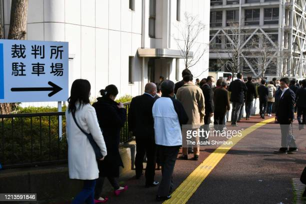 People line up in front of the Chiba District Court for a lottery to attend the verdict in the trial of Yuichiro Kurihara, who was charged with...