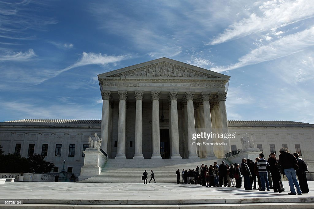 People line up in front of the United States Supreme Court building to hear arguments in two cases coming before the court November 4, 2009 in Washington, DC. The court will hear arguments in Wood v. Allen and Pottawattamie County v. McGhee, a case that will determine how immunity is applied to prosecutors during a case.