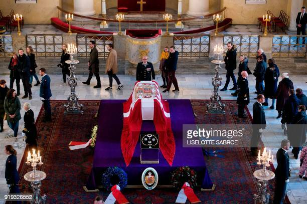 People line up inside Christiansborg Palace Church to see the coffin of late Price Henrik n Castrum Doloris in Copenhagen on February 17 2018 The...