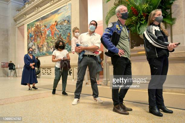 People line up inside the entrance on reopening day at The Metropolitan Museum of Art on August 29 2020 in New York City Museums and cultural...
