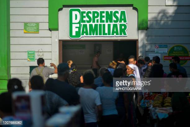 People line up outside a super market as only fifty customers are allowed inside at a time on March 19 2020 in San Salvador El Salvador One case of...