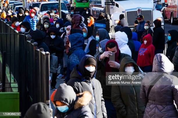 People line up outside Elmhurst Hospital to get tested due to coronavirus outbreak on March 24 2020 in Queens New York City New York City has about a...