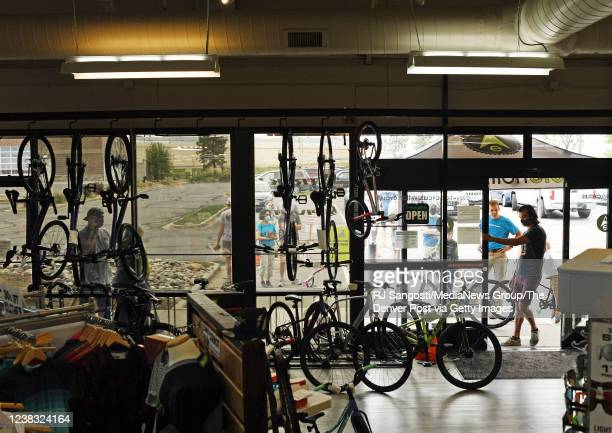 People line up outside for their turn to get into at Elevation Cycles bike shop May 31, 2020 in Highlands Ranch, Colorado.