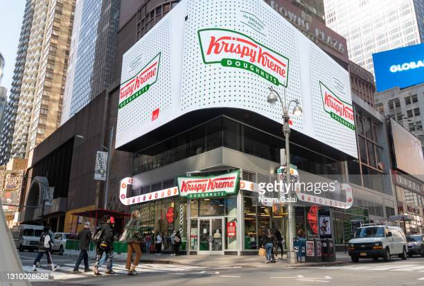 People line up outside Krispy Kreme in Times Square amid the coronavirus pandemic on March 30, 2021 in New York City. Beginning on March 22 Krispy...