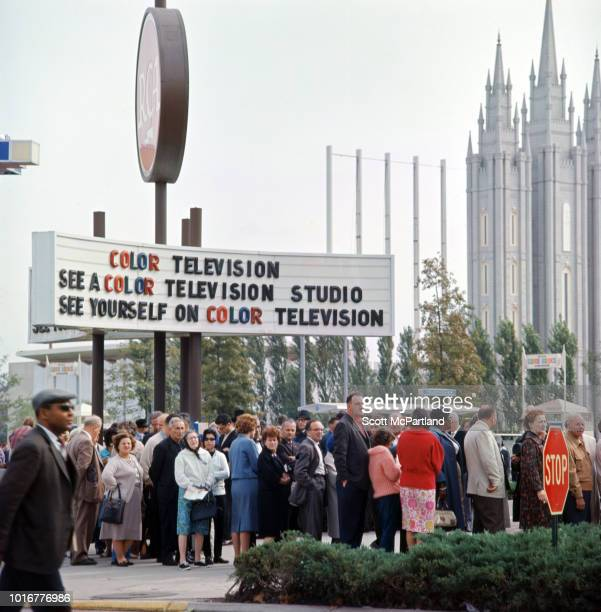 People line up outside the RCA Pavilion during the World's Fair in Flushing Meadows Park Queens New York New York April 1965 A sign outside reads in...