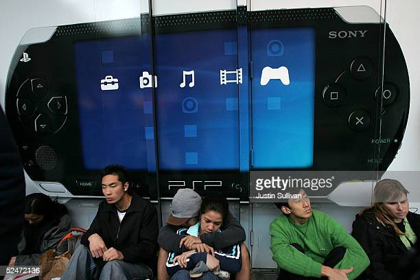 People line up outside the Sony store to be the first to buy the new Sony PSP Playstation Portable gaming unit March 23 2005 in San Francisco...