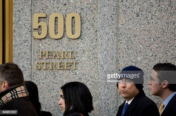 People line up outside to enter federal court in New York US on Thursday March 12 2009 Bernard Madoff founder of Bernard L Madoff Investment...