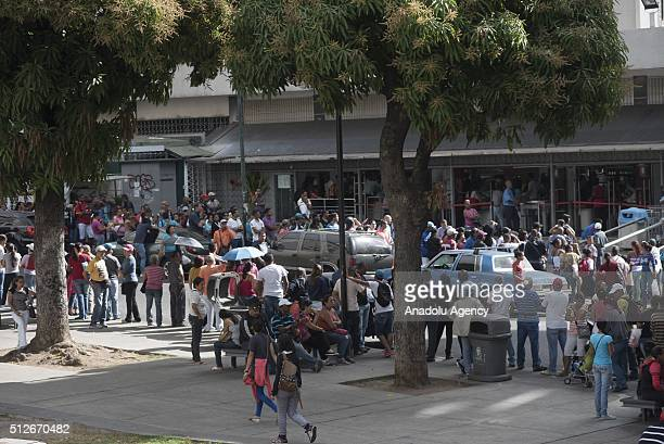 People line up to buy basic products outside a supermarket in Caracas Venezuela on February 27 2016 Venezuela suffers from the shortage of food...