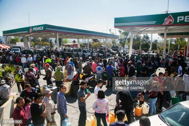 People line up to buy gasoline at a gas station in Morelia Michoacan state one of several Mexican states where shortages have been reported on...