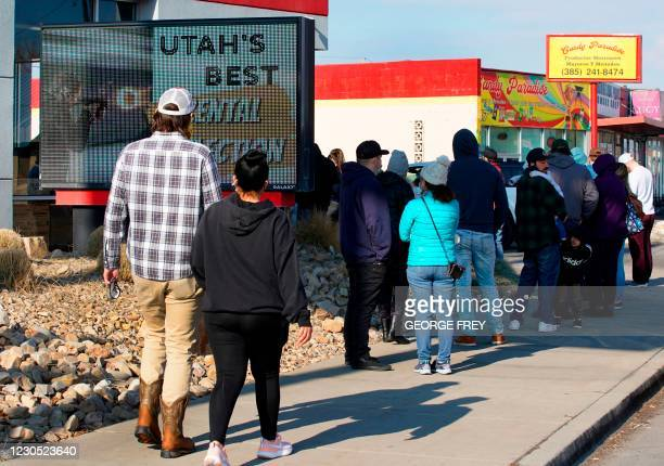 People line up to buy guns and ammunition at the Ready Gunner gun store on January 10, 2021 in Orem, Utah. - Ammunition and guns sales have spiked in...