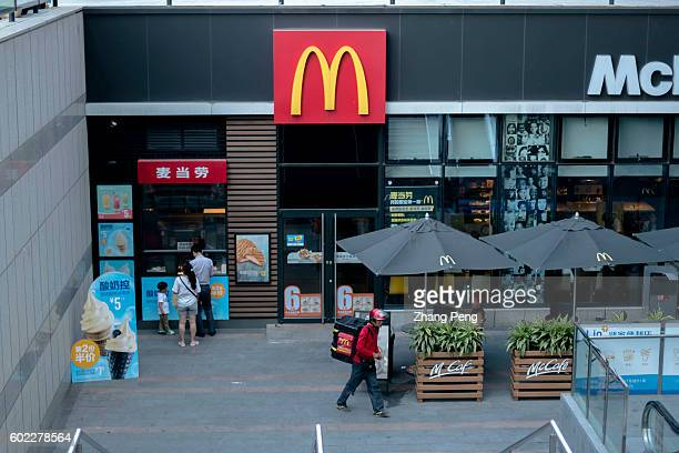 People line up to buy icecream from a McDonald's restaurant While Yum brands entered into a deal with Chinese local investors facing a declining...
