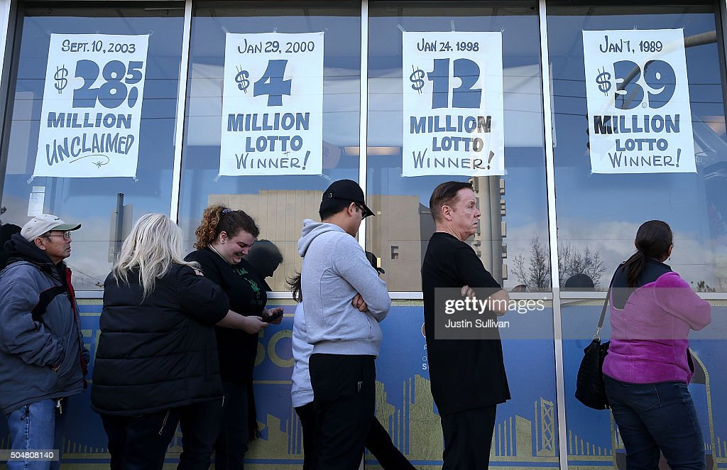 People line up to buy Powerball tickets at Kavanagh Liquors on January 13, 2016 in San Lorenzo, California. Dozens of people lined up outside of Kavanagh Liquors, a store that has had several multi-million dollar winners, to -purchase Powerball tickets in hopes of winning the estimated record-breaking $1.5 billion dollar jackpot.