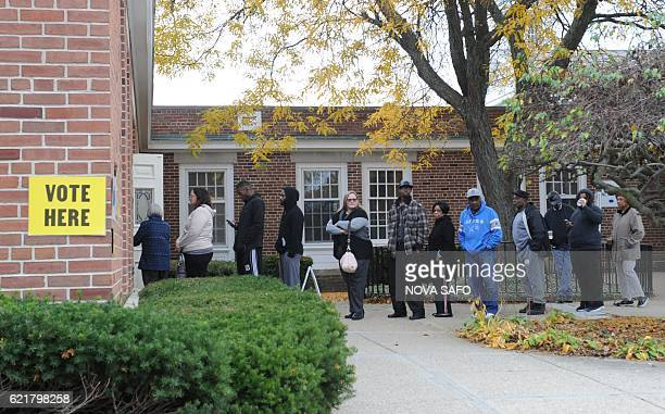 People line up to cast their ballots at a polling station on November 8 2016 in Flint Michigan which made global headlines as a city blighted by a...