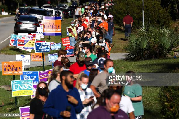 People line up to cast their in-person absentee ballots at the Berkeley County Library on October 30, 2020 in Hanahan, South Carolina. Voters waited...