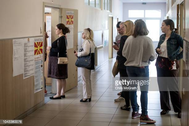 People line up to cast their referendum vote at a voting station on September 30 2018 in Skopje Macedonia Macedonians all across the country went to...