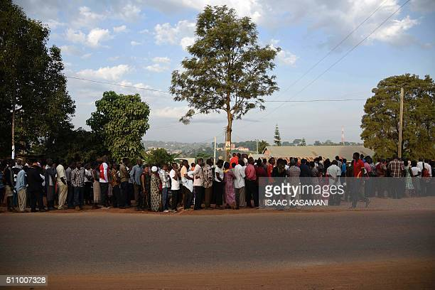 People line up to cast their vote in presidential and parliamentary polls on February 18 2016 at the Nasuti polling station in Mukono District some...