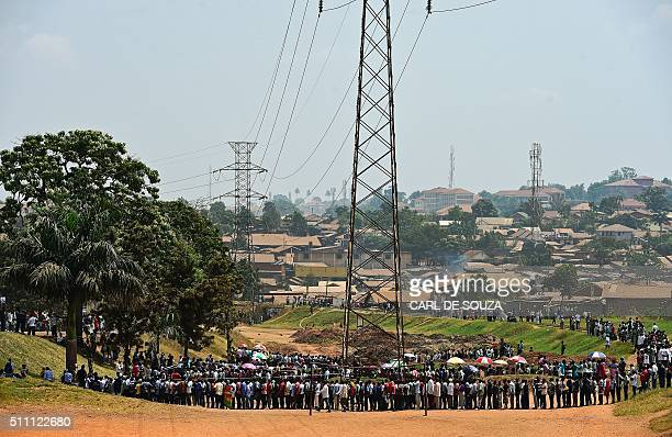 TOPSHOT People line up to cast their vote in presidential and parliamentary polls on February 18 2016 at the Nasuti polling station in Mukono...