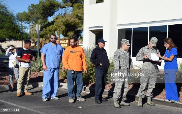 People line up to donate blood at a special United Blood Services drive at a University Medical Center facility to help victims of a mass shooting on...