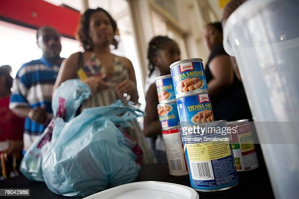 People line up to donate canned goods in exchange for an autographed photo of singer Beyonce and a raffle ticket before a Beyonce concert August 9,...