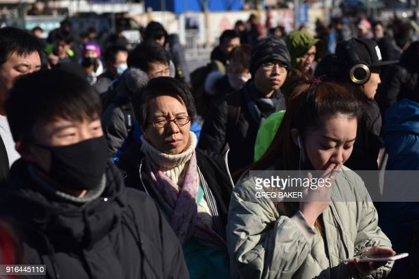 People line up to enter a railway station in Beijing on February 10 as travellers depart the capital ahead of the Lunar New Year China is in the...