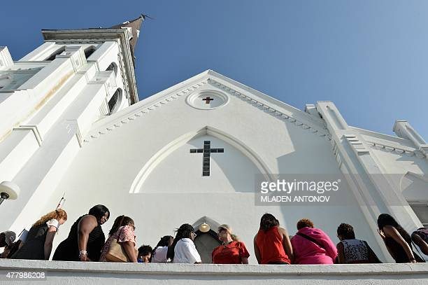 People line up to enter for Sunday service at the Emanuel AME Church in Charleston South Carolina on June 21 2015 Large crowds are expected at...