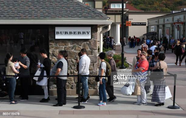 People line up to enter the Burberry store at the Woodbury Common Premium Outlets Mall on October 21 2017 in Central Valley NY