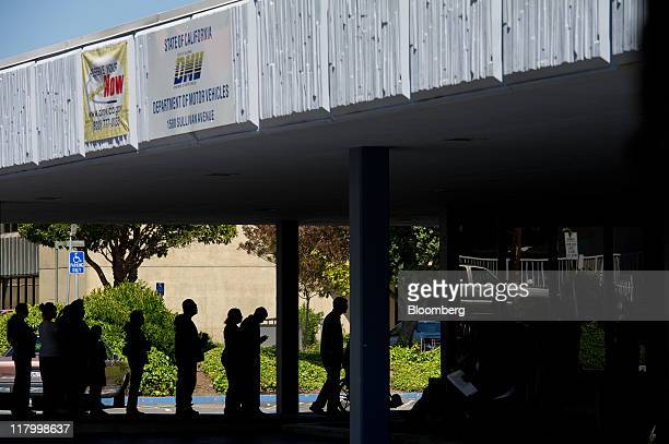 People line up to enter the Department of Motor Vehicles in Daly City California US on Friday July 1 2011 Taxes and fees on new cars sold in...