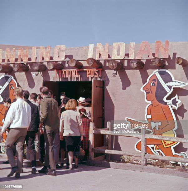 People line up to enter the 'Running Indian Trading Post' at the American Indian Exposition at the World's Fair in Flushing Meadows Park Queens New...