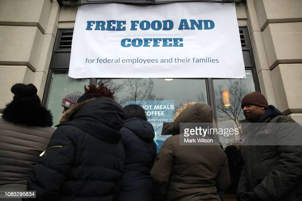 People line up to get a free lunch at a popup eatery hosted by Celebrity Chef Jose Andres for furloughed government employees and their families on...