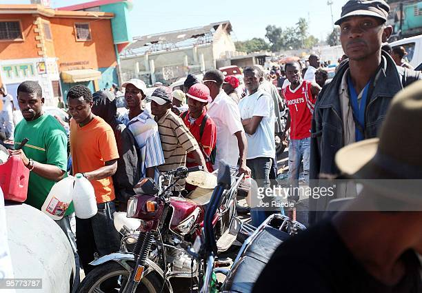 People line up to get gasoline after the massive earthquake destroyed buildings and infrastructure on January 14 2010 in PortauPrince Haiti...