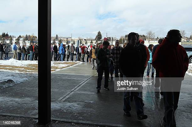 People line up to hear Republican presidential candidate former Massachusetts Gov Mitt Romney speak at a campaign rally at Skyline High School on...