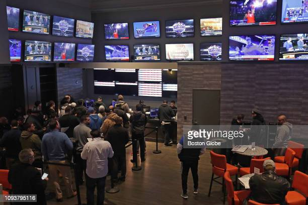 People line up to place bets at the sports book bar at Twin River Casino in Lincoln RI on Jan 29 2019