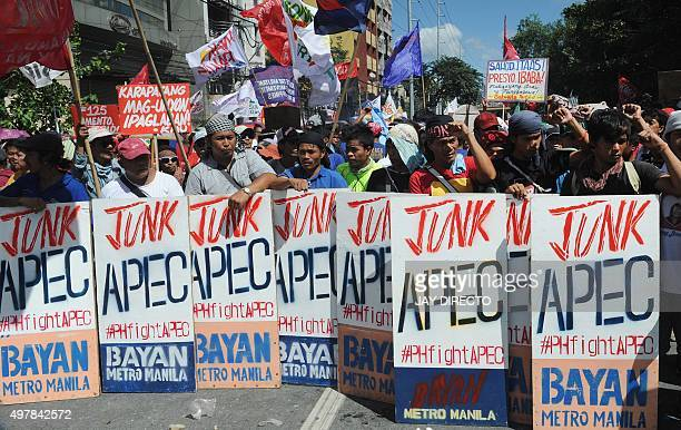 People line up to protest to voice their opposition to the AsiaPacific Economic Cooperation Summit taking place in Manila on November 19 2015 Riot...