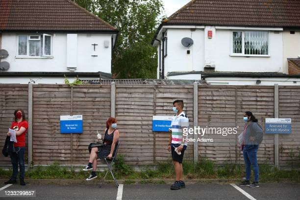People line up to receive a vaccination on June 6, 2021 in Stanmore, Greater London. Belmont Health Centre saw long queues over the weekend after...