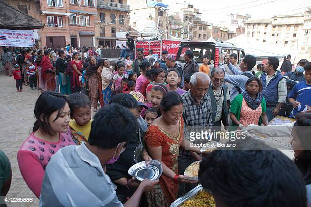 People line up to receive food in Bhaktapur A major 79 earthquake hit Kathmandu midday on Saturday April 25th and was followed by multiple...