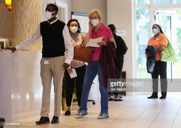 People line up to receive the Pfizer-BioNtech COVID-19 vaccine at the John Knox Village Continuing Care Retirement Community on January 6, 2021 in...